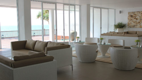 Indoor area with sea view at the Michelle Boutique