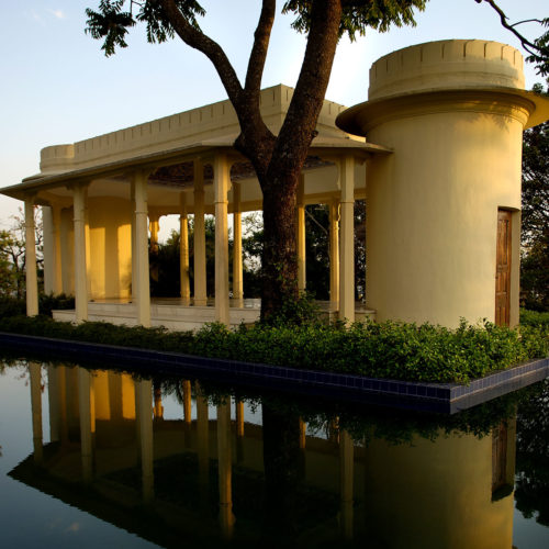 Indian building in the middle of a pool