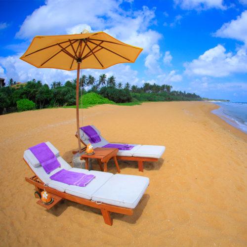 Sun beds on the beach at the aditya resort