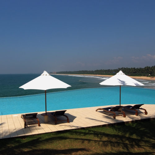 infinity edge pool with 4 reclinable chairs