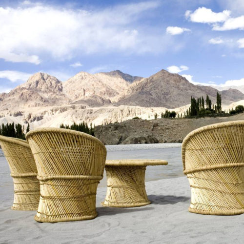 chairs facing mountains