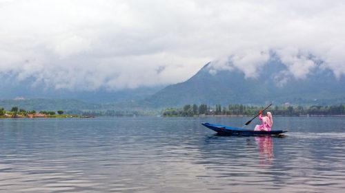 Man in a boat on Dal Lake in Kashmir
