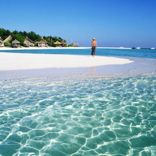 Greaves India Maldives woman walking on a beautiful beach