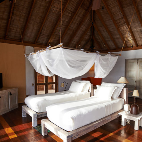 A bedroom in the gili-lankanfushi resort