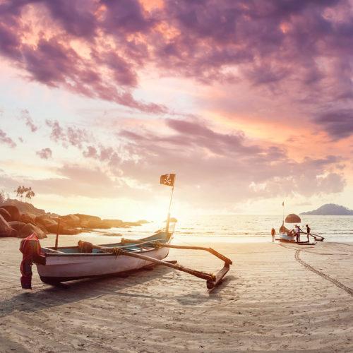 Goa beach. Fishing boat at sun rise