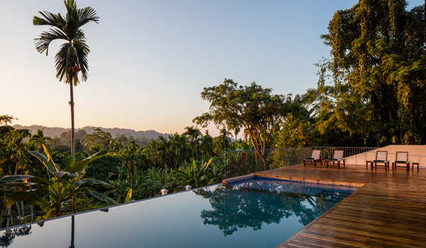 Jalakara's infinity pool overlooks the jungle foliage © Ed Reeve