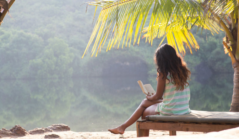 Discover Goa | Reading under palms