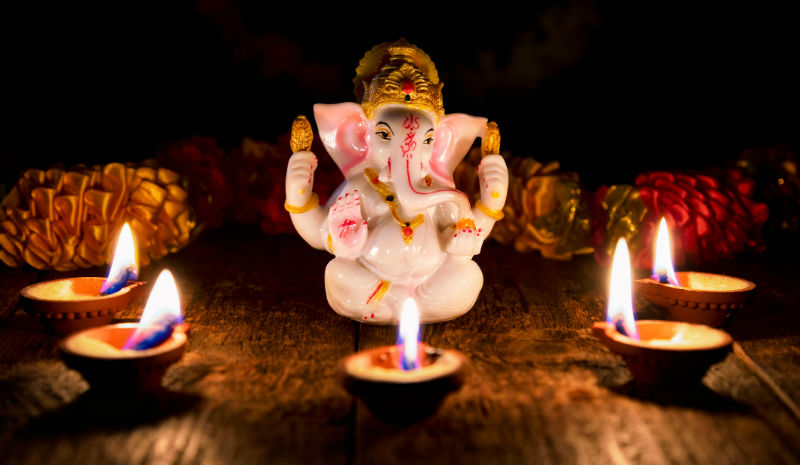Temple Etiquette | Ganesha and candles