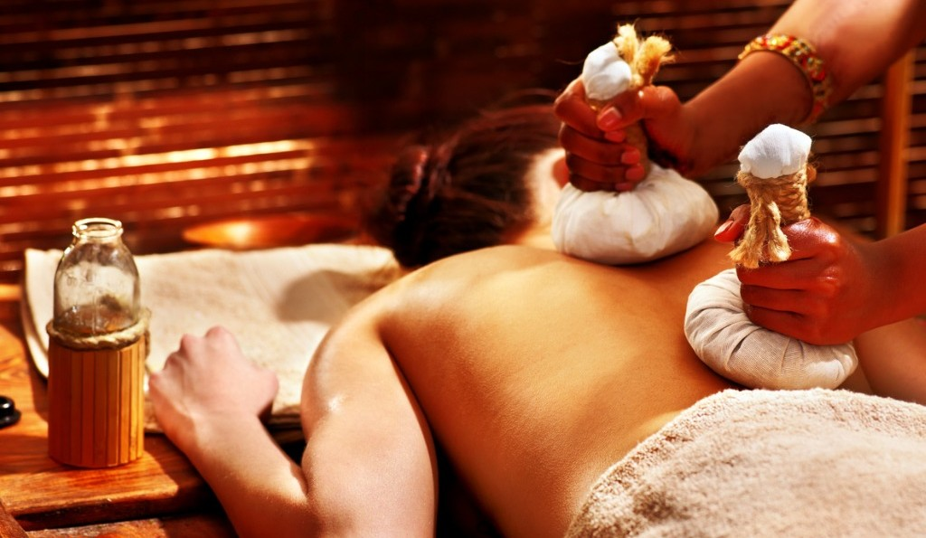Best Ayurvedic Massage in London | woman-having-massage-with-pouch-picture-id491683745